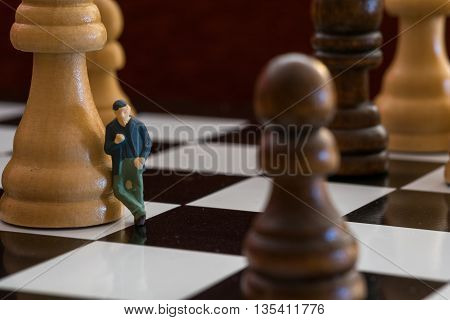 Little Person Leaning Against a Chess Piece #2