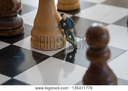 Little Person Leaning Against a Chess Piece