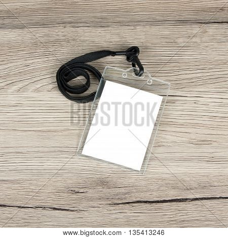 Name id card badge with cord on wooden background