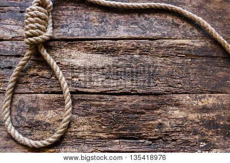 Rope With A Slipknot On The Wooden Background