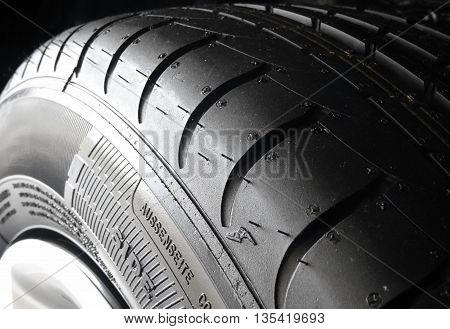 Tread blocks and ribs on the symmetrical tire macro shot