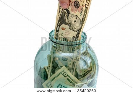 money is invested in a glass jar isolated on white background