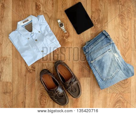 Top View Of Stylish Clothes Isolated On Wooden Background