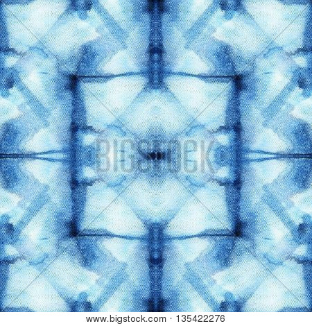 Beautiful seamless tie-dye pattern of indigo color on white silk. Batik-hand painting fabrics - nodular batik. Shibori dyeing.