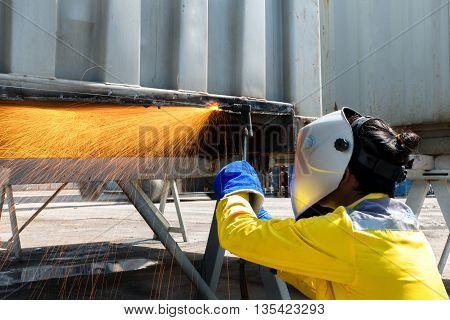 Industry Woker Welding concept - Industry worker with protective mask welding steel to repair container structures manufacture workshop. Worker welding in factory industry.