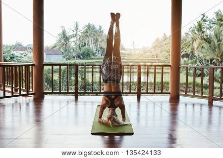 Fitness Woman Doing Sirsasana Yoga