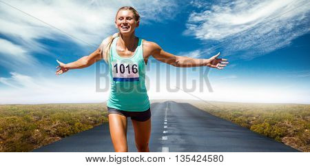Sportswoman finishing her run against view of an empty street