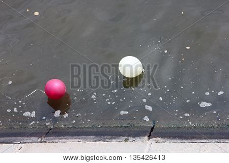 two balloons on the water of river after party