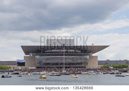 Copenhagen, Denmark - June 18, 2016: Cliff Diver ready to jump from Opera House at Red Bull cliff diving event.