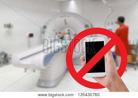 Don't use your mobile phone Recording videos and photos in the hospital.CT scan test in examination room background