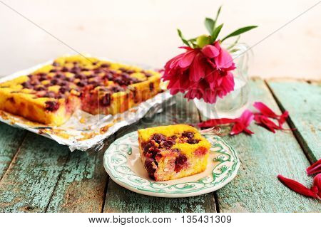 Homemade quark pie with chocolate sauce and red peony horizontal