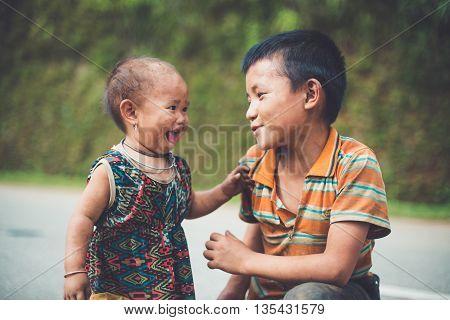 MUCANGCHAI, VIETNAM, JUNE 12, 2016: H'mong ethnic minority kids near terraced rice field in Mucangchai, Vietnam. H'mong is the 8th largest ethnic group in Vietnam.