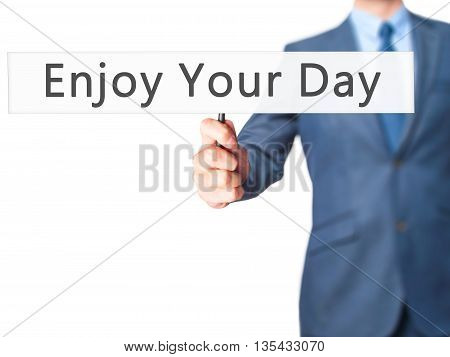 Enjoy Your Day - Businessman Hand Holding Sign