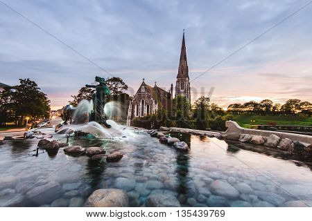 Gefion Fountain And St. Alban's Church In Copenhagen, Denmark.