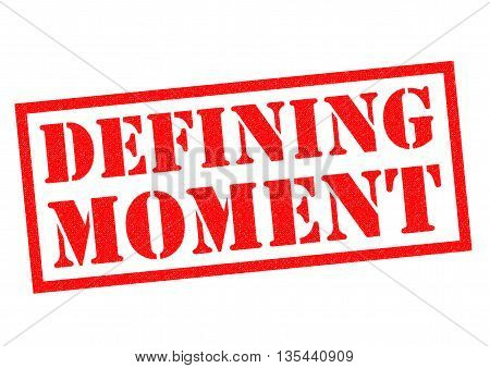DEFINING MOMENT red Rubber Stamp over a white background. poster