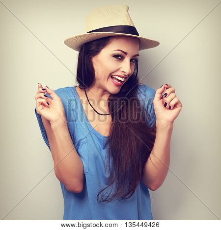 Happy Giggling Young Woman With Straw Hat Looking In Camera. Toned Vintage Portrait