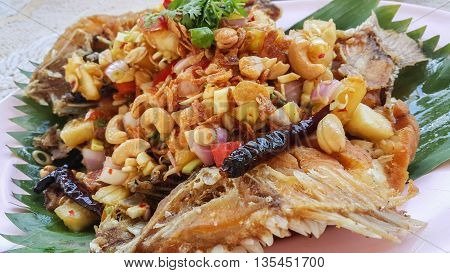 Herb salad with deep fried fish (Thai fusion and healthy food)