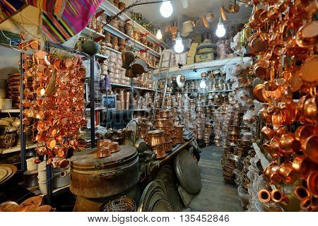 SHIRAZ - APRIL 14: Unknown man trades traditional metal crafts in a market (Vakil Bazaar) in Shiraz Iran on April 14 2015. Vakil Bazaar is the most important tourist attraction in Shiraz Iran.