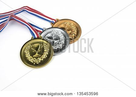 Gold siver and bronze medals with trophy symbol on white background