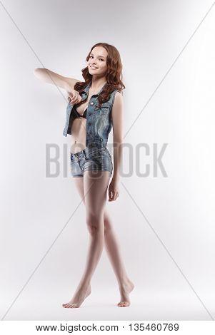 Studio photo of smiling teenage girl posing on casting