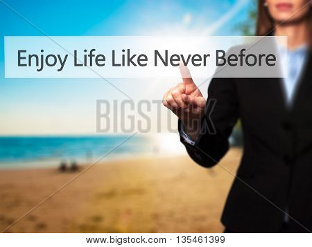 Enjoy Life Like Never Before - Businesswoman Hand Pressing Button On Touch Screen Interface.