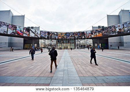BRUSSELS, BELGIUM - MARCH 16: Wide angle shot with people walking by European Parliament's Leopold Square on March 16, 2016 in Brussels.