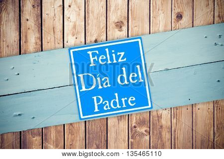 Word Feliz dia del padre against painted blue wooden planks