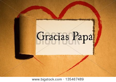Word gracias papa against directly above shot of torn brown paper