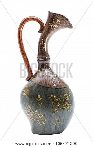 Antic gold engraved wooden handmade vase with handle in oriental style on isolated background.