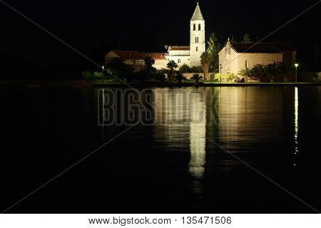 Night reflection of Franciscan Monastery in Vis Harbour, Croatia