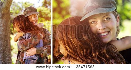 A soldier mother hugging her daughter against happy soldier reunited with her daughter