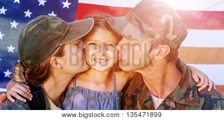 Soldier couple reunited with their daughter in front of american flag