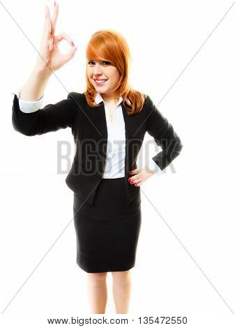 Business gesture and office concept. Attractive redhair smiling businesswoman or student girl showing gesturing ok sign. Isolated on white background