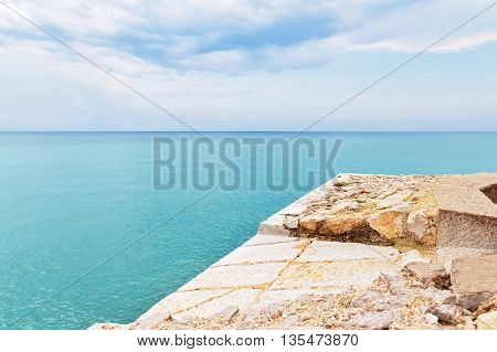 Waterfront and turquoise sea of Peniscola resort in the province of Castellon Valencian Community Spain.