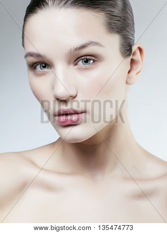 young sweet brunette woman close up isolated on white background, perfect pure innocense, spa people concept