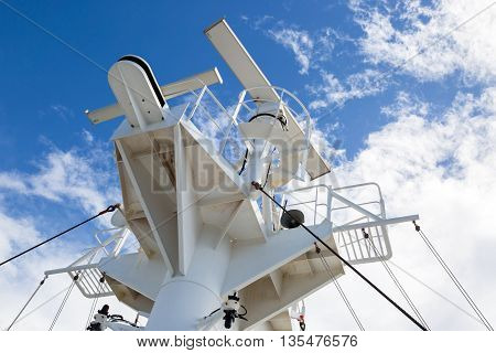 Sattelite communication antenna and radar mast on the top deck of the ship.