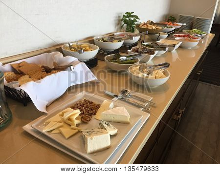 A table of finger foods for a hotel club lounge happy hour.