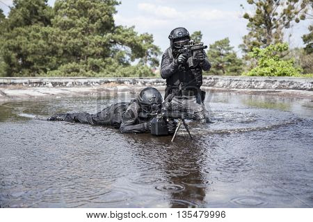 Spec ops police officers SWAT in action in the water