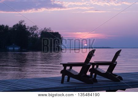 Lake view during sunset at the cottage from the dock against a beautiful purple sky