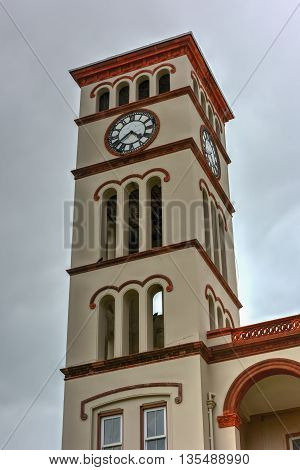 Hamilton, Bermuda - May 20, 2016: Florentine Clock Tower of the Bermuda Parliament (Sessions House) in Hamilton on Parliament Hill.