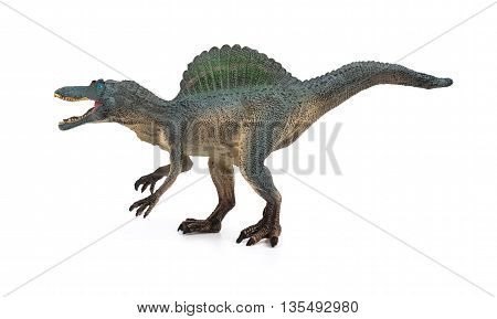 side view grey grey spinosaurus toy on a white background