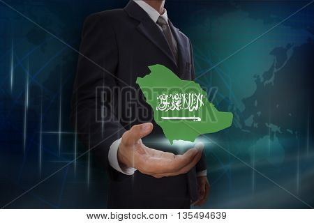 Businessman showing map of Saudi Arabia on globe background
