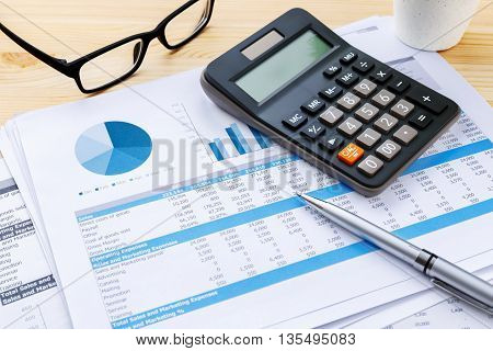 Financial Chart With Calculator And Pen