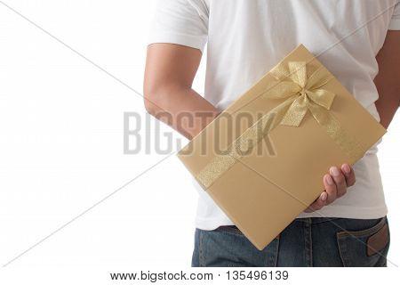 Man hiding a golden gift box giving for surprise