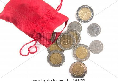 Thai money in red bag on white background