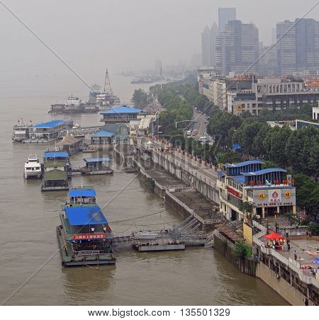 Wuhan, China - June 22, 2015: people are doing some work in one of docks of Wunah, China