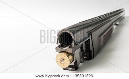 Charging double-barreled hunting rifle. Close up view focus on the shotgun.