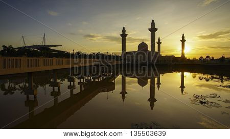 Reflection of a modern beautiful mosque during blue hour sunrise in Shah Alam Malaysia.