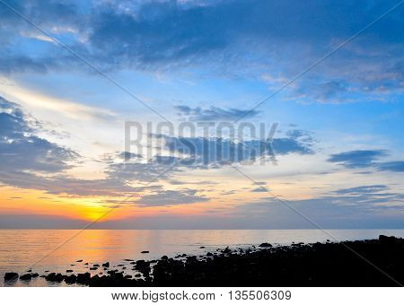 sunset and nice sky view on the rock beach