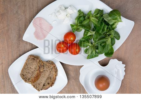 Healthy Breakfast With Eggs, Tomatoes, Fresh Salad And Jam